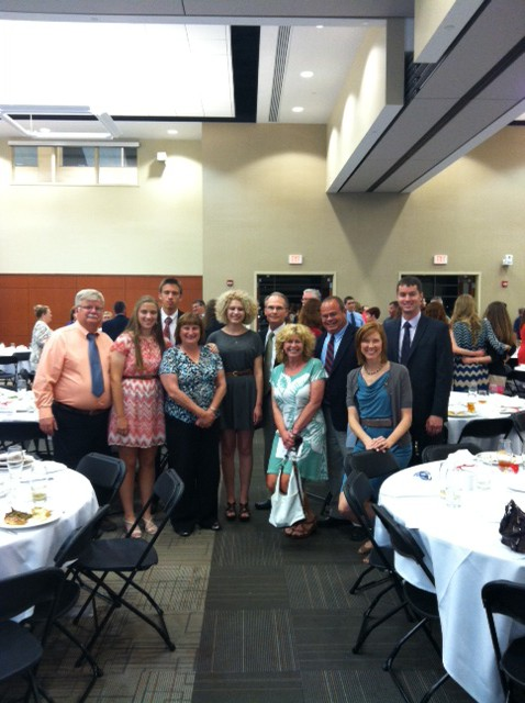 Scholarship recipients Annie Luckadoo and Rachel Queen with members of their family and the AmRest team.